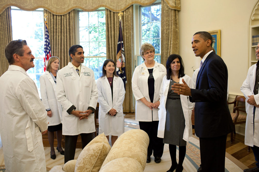 a diverse group of doctors meeting president obama